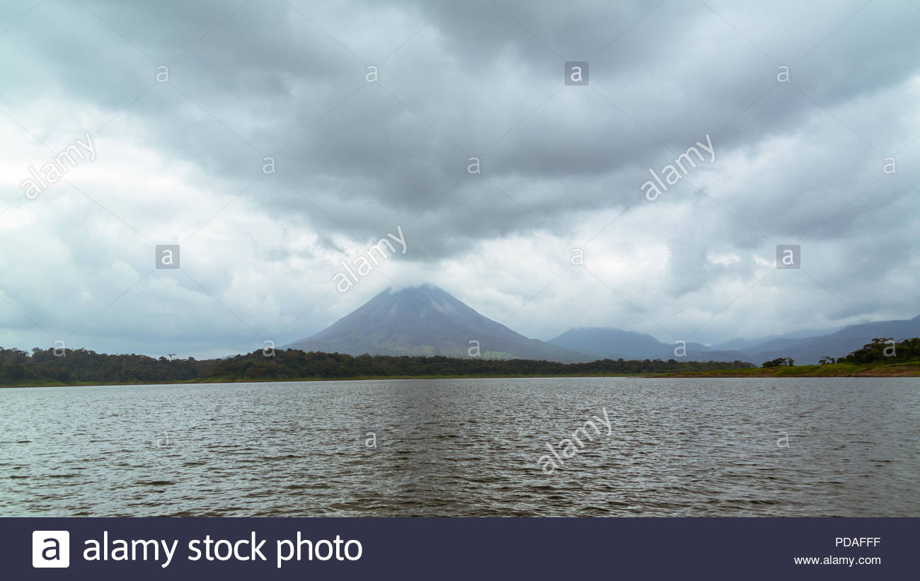 Arenal Volcano as seen from Lake Arenal - Stock Image