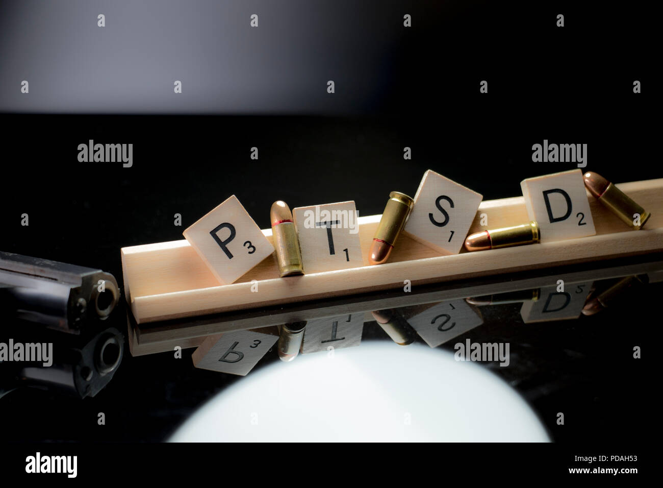 PTSD and self harm awareness concept with text blocks, bullets and black hand gun, - Stock Image