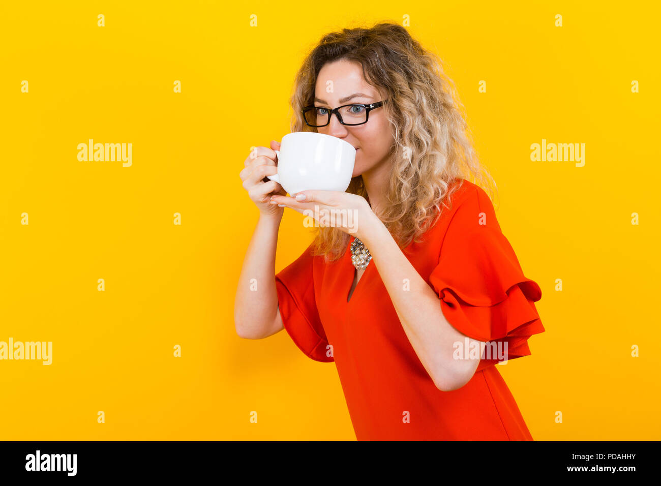 Woman in dress with cup - Stock Image