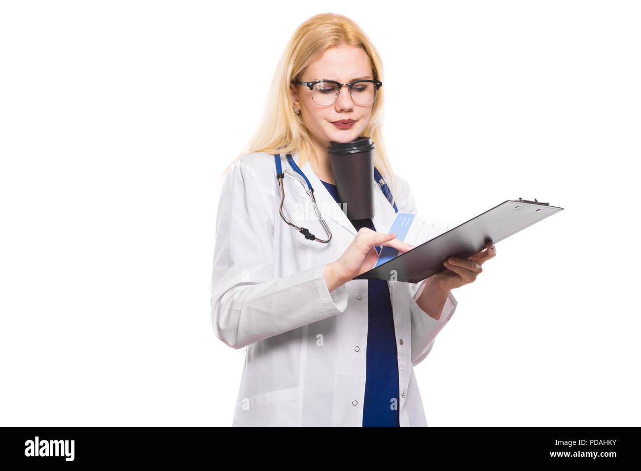 Woman doctor with stethoscope and clipboard - Stock Image
