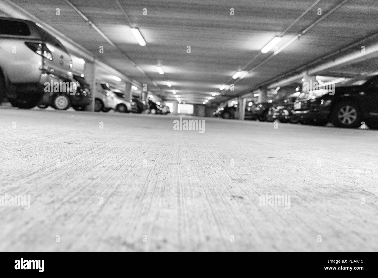 Low angle view of a carpark with parked cars in Wellington, New Zealand - Stock Image
