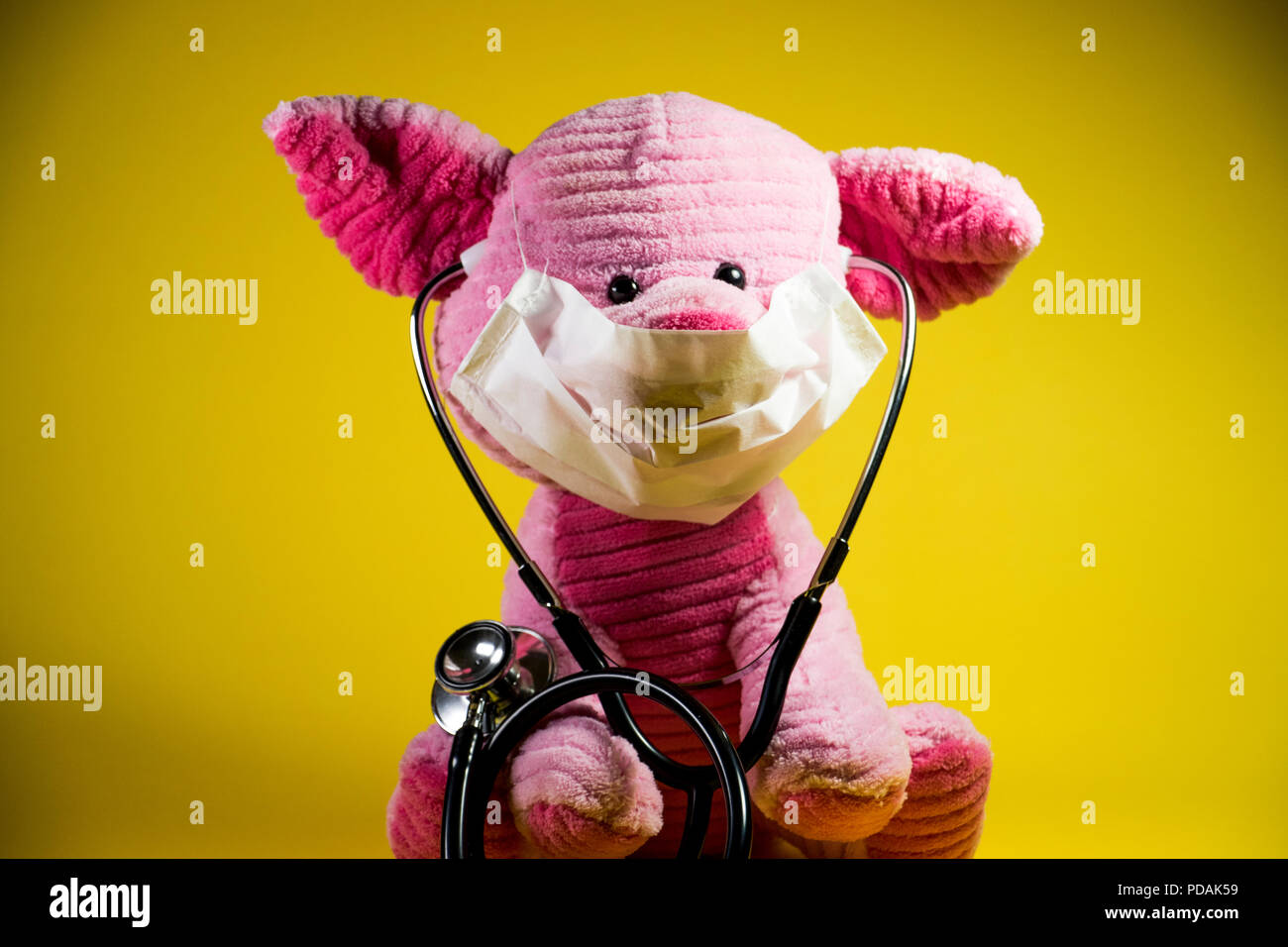 Swine flu concept. Plush toy with beady eyes and pig snout. - Stock Image