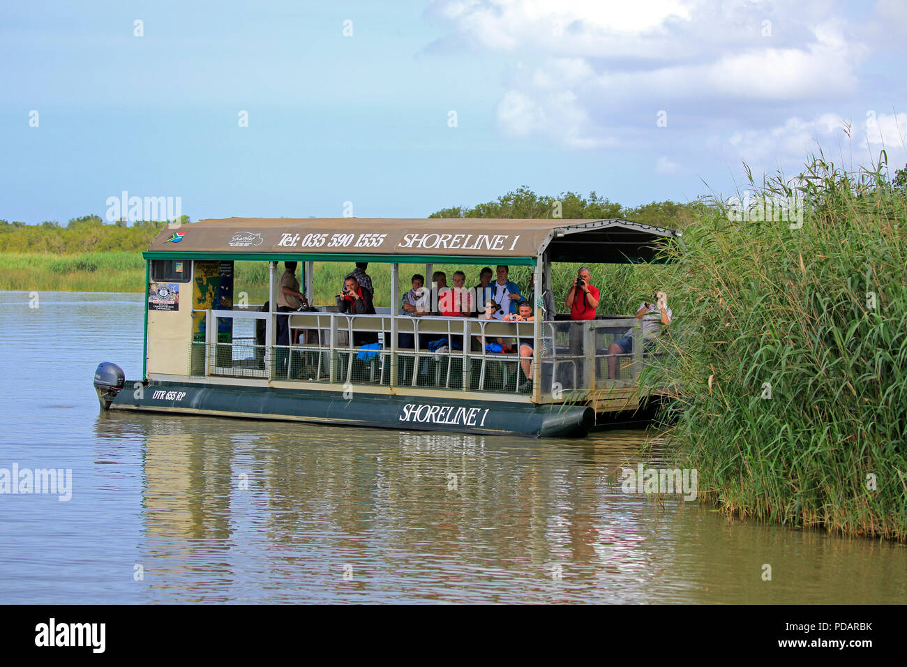 Excursion boat, tourists on boat safari, St Lucia, St Lucia Estuary, Isimangaliso Wetland Park, Kwazulu Natal, South Africa, Africa Stock Photo