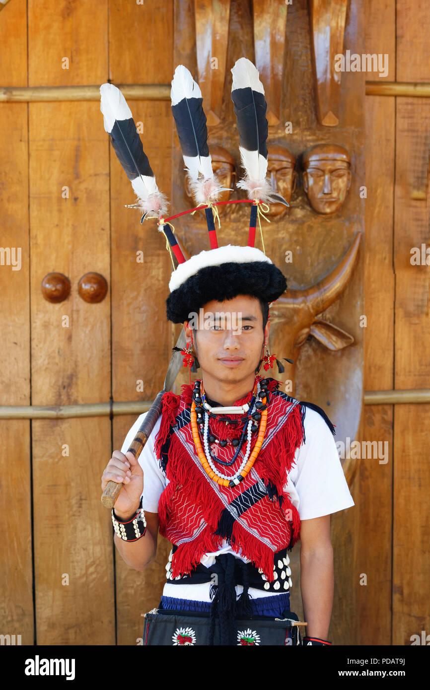 Naga tribal man in traditional outfit, Kisima Nagaland Hornbill festival, Kohima, Nagaland, India - Stock Image