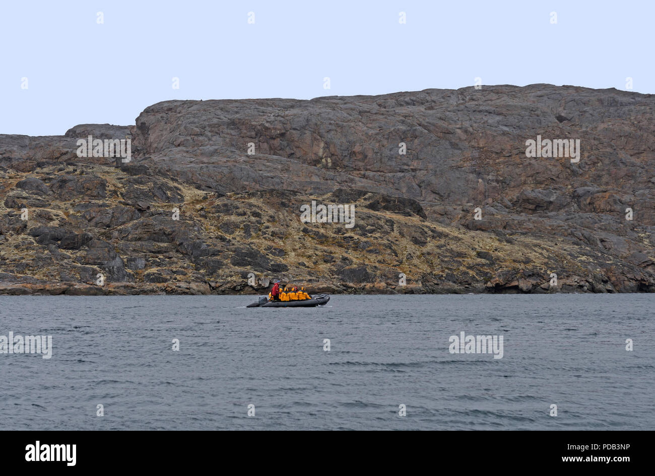 Explorers Cruising the Arctic in a Raft near the Lower Savage Islands on Baffin Isalnd in Nunavut, Canada - Stock Image