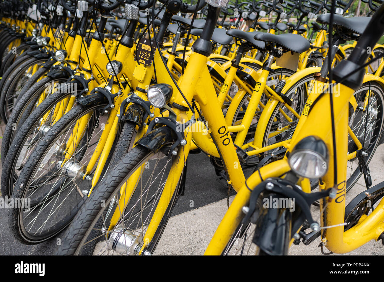 Pathum Thani, Thailand - May 3, 2018 : Ofo bikes are parked on the side of the road. Ofo is a bike-sharing service provider. - Stock Image