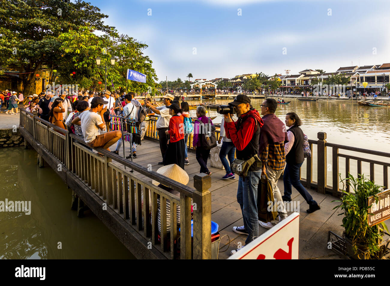 Dec. 08, 2017, Hoi An Ancient Town, VN. A crowd on the bridge that overlooks the famous Japanese bridge. Tourists taking pictures and walki Stock Photo
