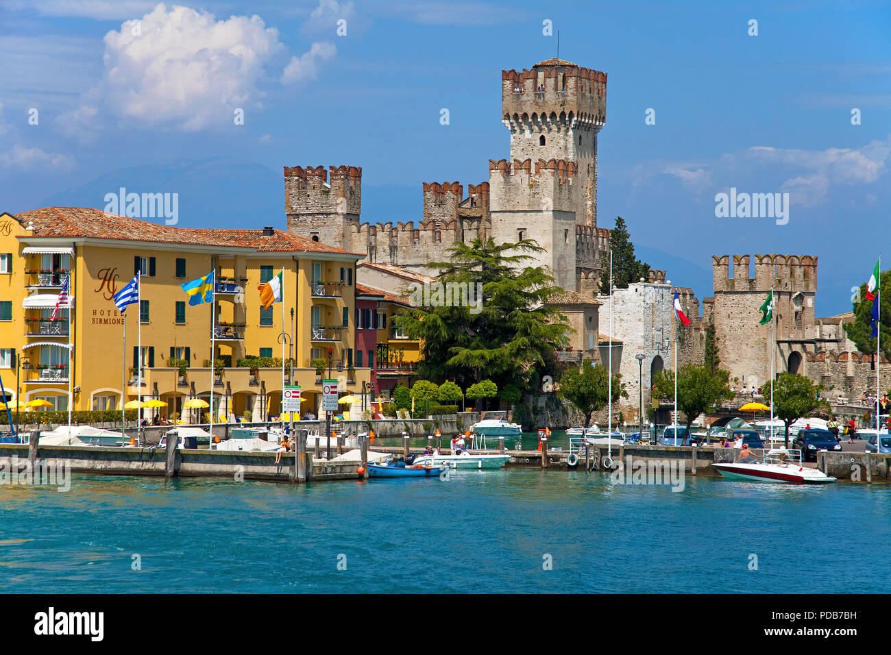 Harbour at Scaliger castle, landmark of Sirmione, Lake Garda, Lombardy, Italy - Stock Image