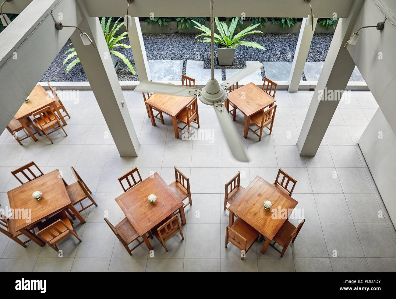 Aerial view of tables and chair in empty cafe of the hotel. Loft interior concept. - Stock Image