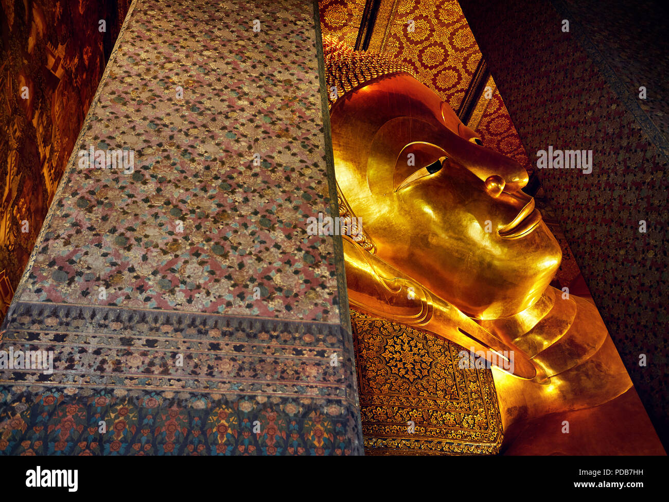 Famous Statue of Big Golden Buddha in wat Pho temple in Bangkok, Thailand. Symbol of Buddhist culture. Stock Photo