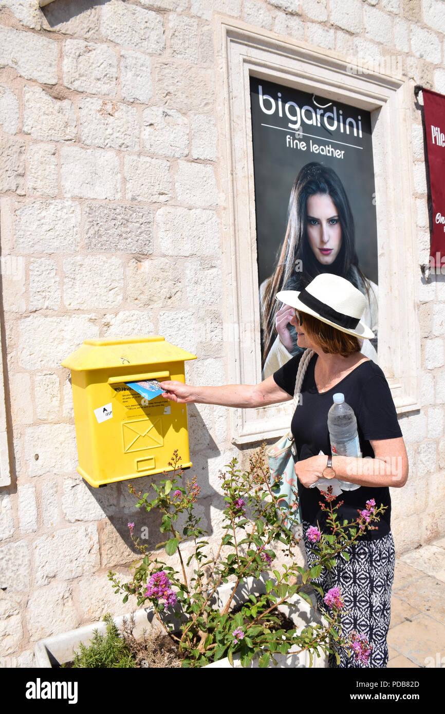 Tourist posting a postcard, Dubrovnik, Croatia, July 2018. MR - Stock Image