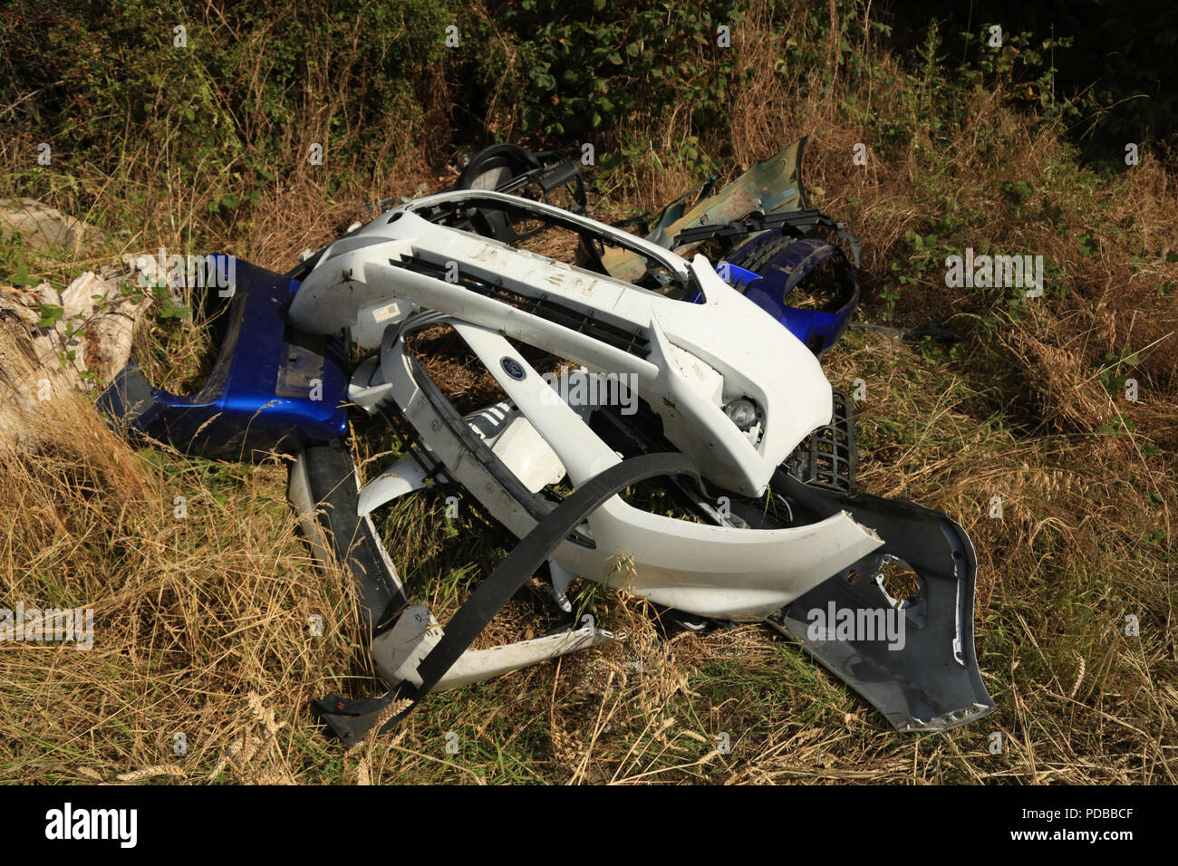 Dumped plastic car parts on farmland in the West midlands, UK. Stock Photo