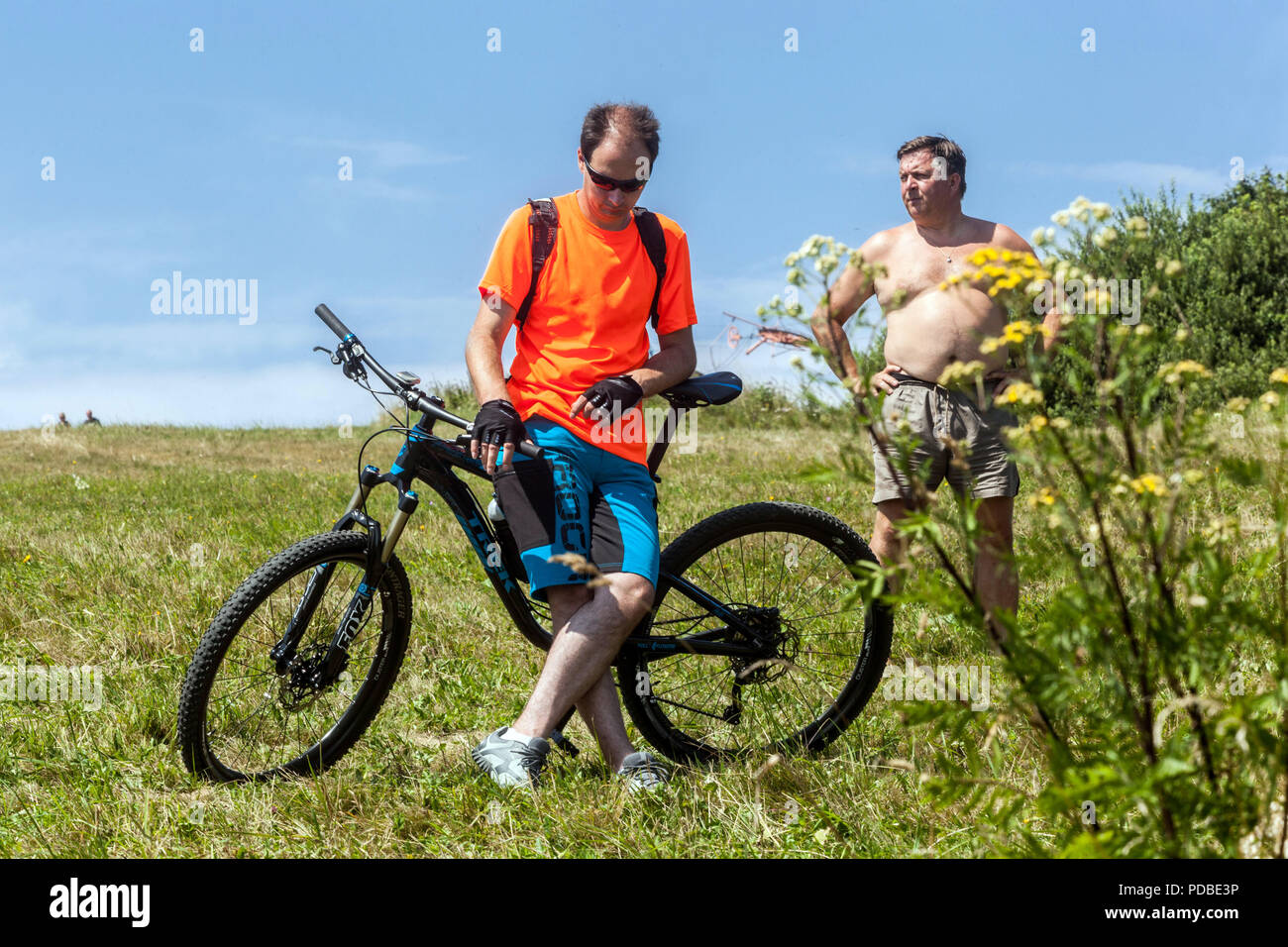 Biker, summer heat, Velka Javorina hill, Czech Slovak border in White Carpathians - Stock Image