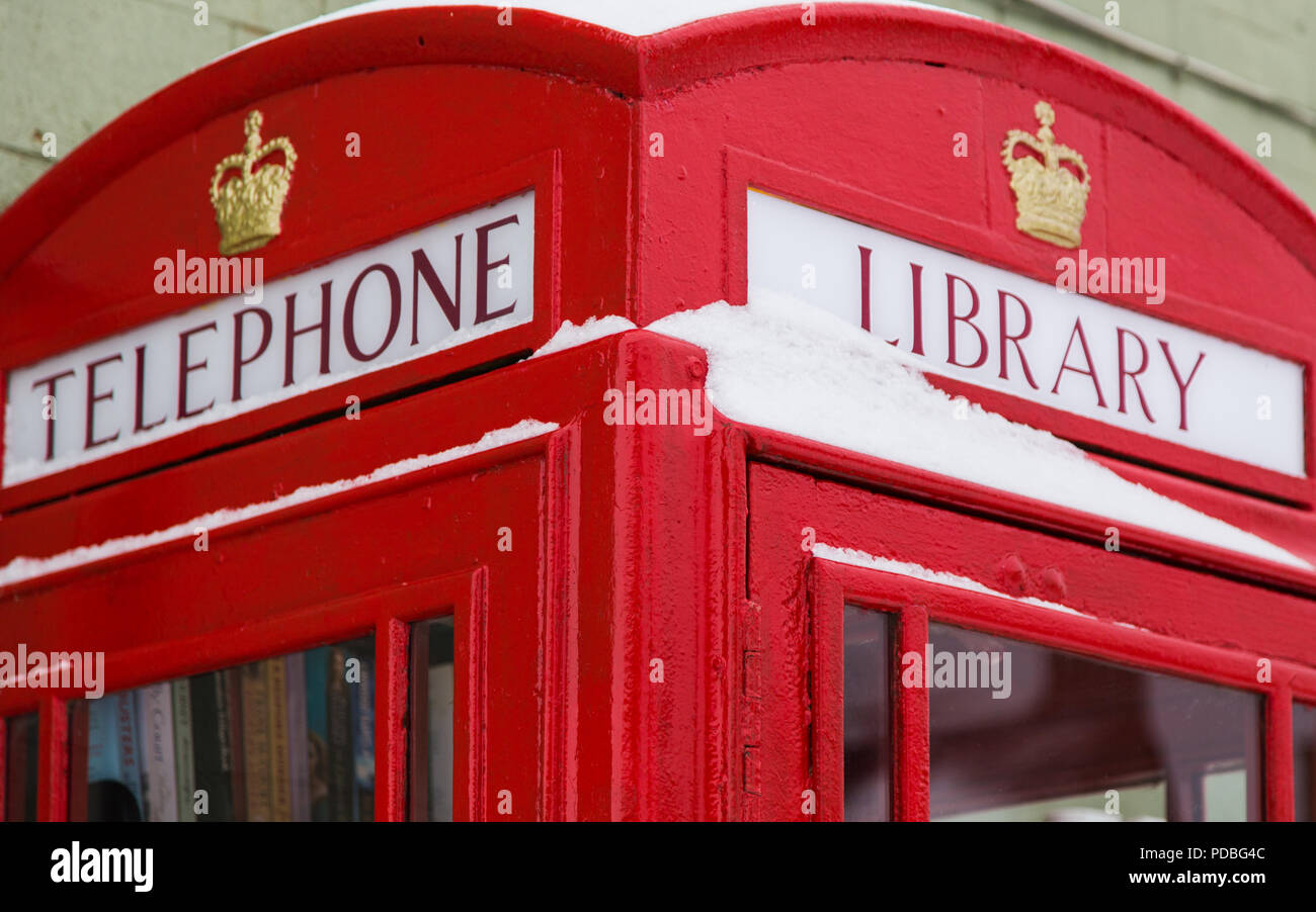 Red telephone box converted to a library, Gloucestershire. - Stock Image