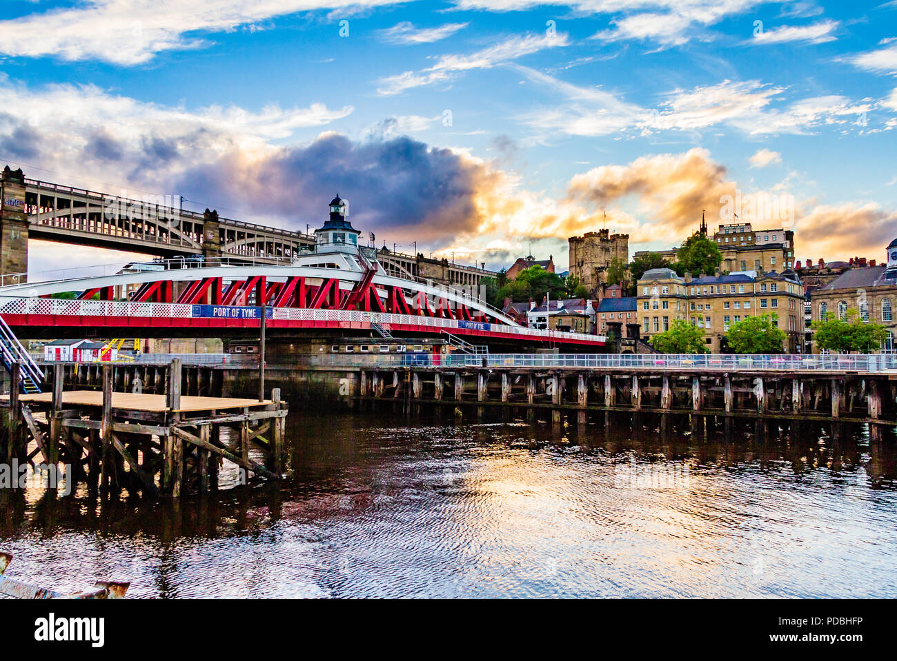 View over the River Tyne looking towards Newcastle Castle, Armstrong's swingbridge and the High Level railway bridge at sunset. Newcastle, UK. - Stock Image