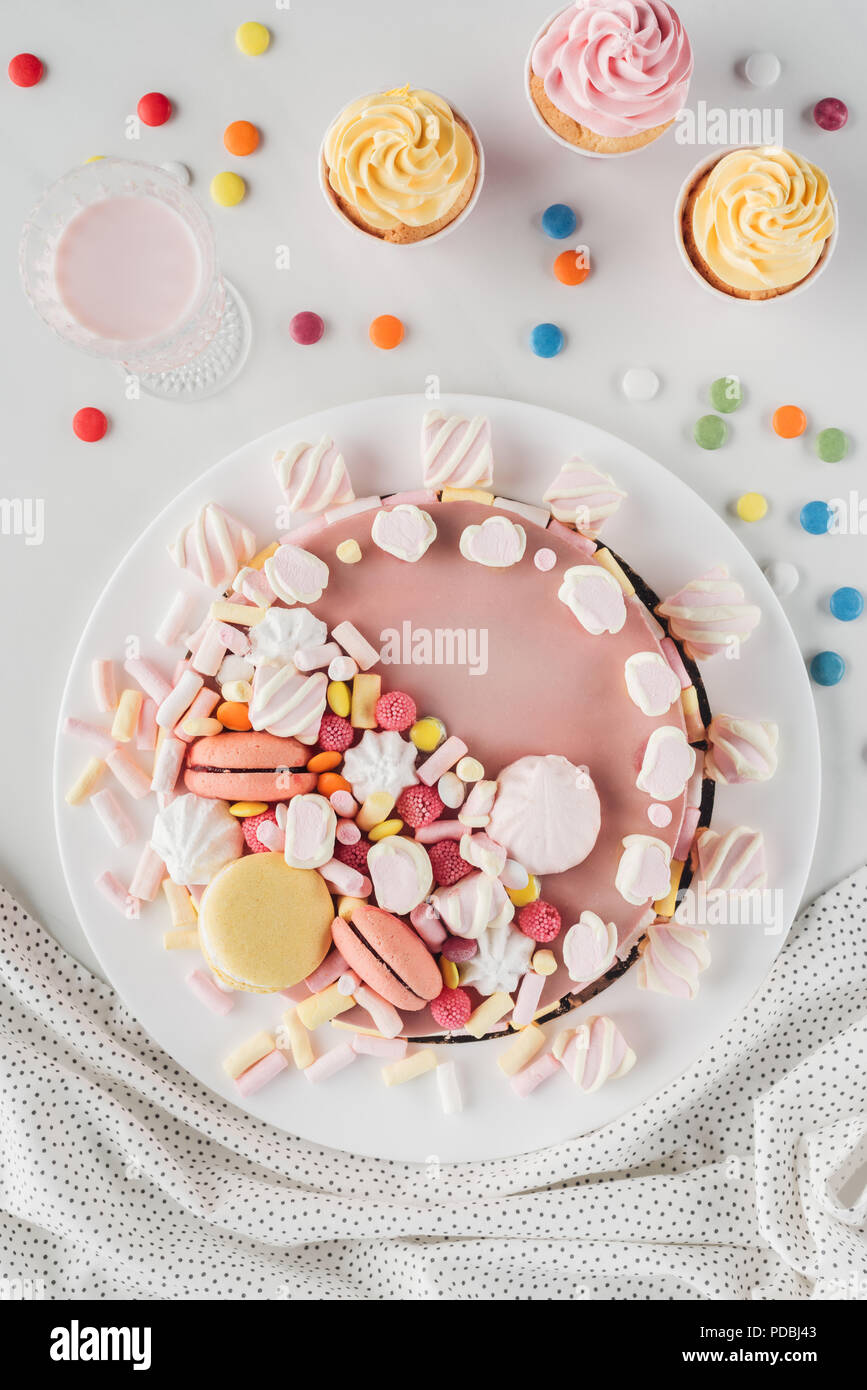 Top View Of Birthday Cake With Marshmallows Candies And Sweet