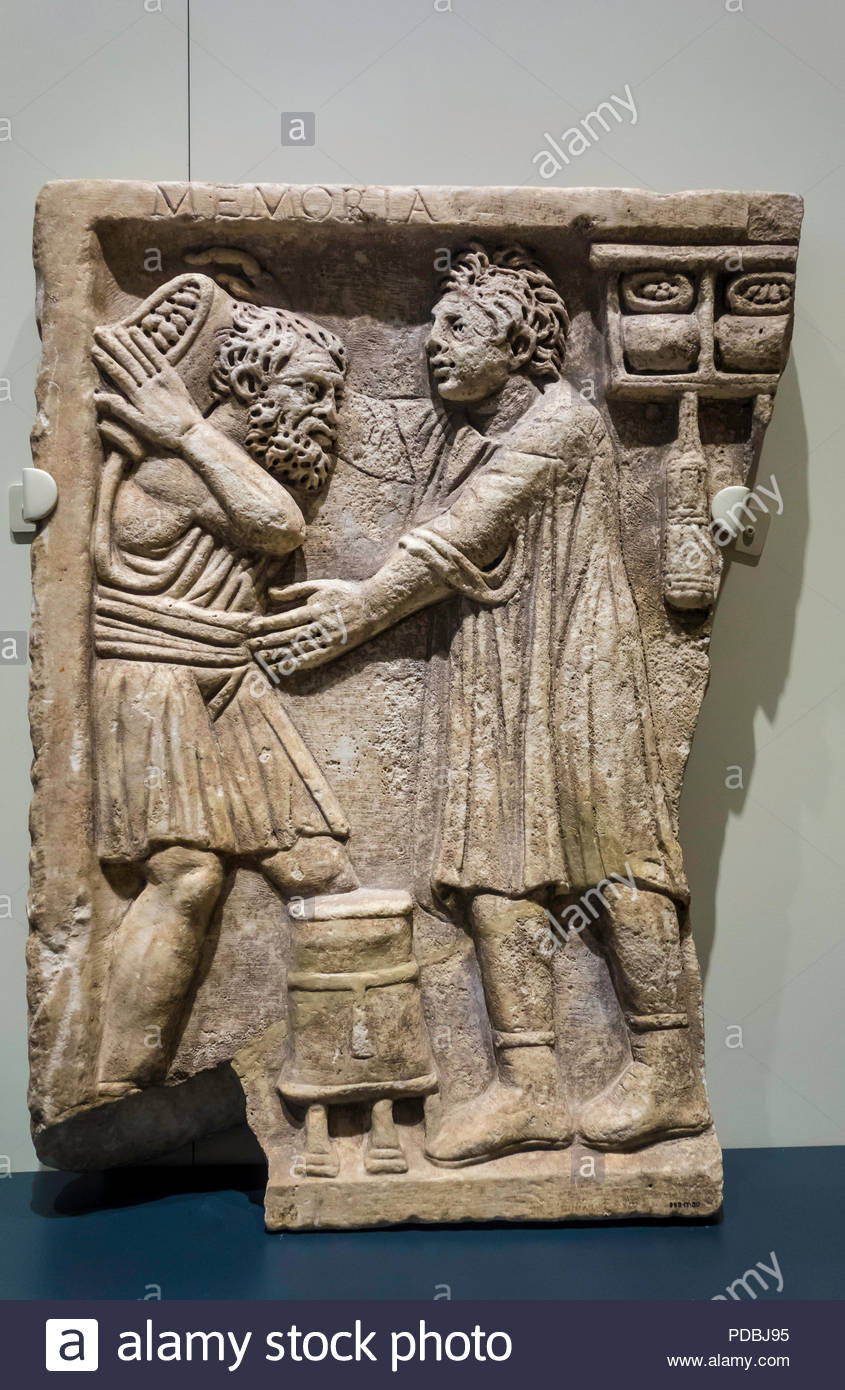 Roman tomb relief shop AD 200-300 labourer delivering goods to shopkeeper (r) at Royal Ontario Museum ROM in Toronto Ontario Canada Stock Photo