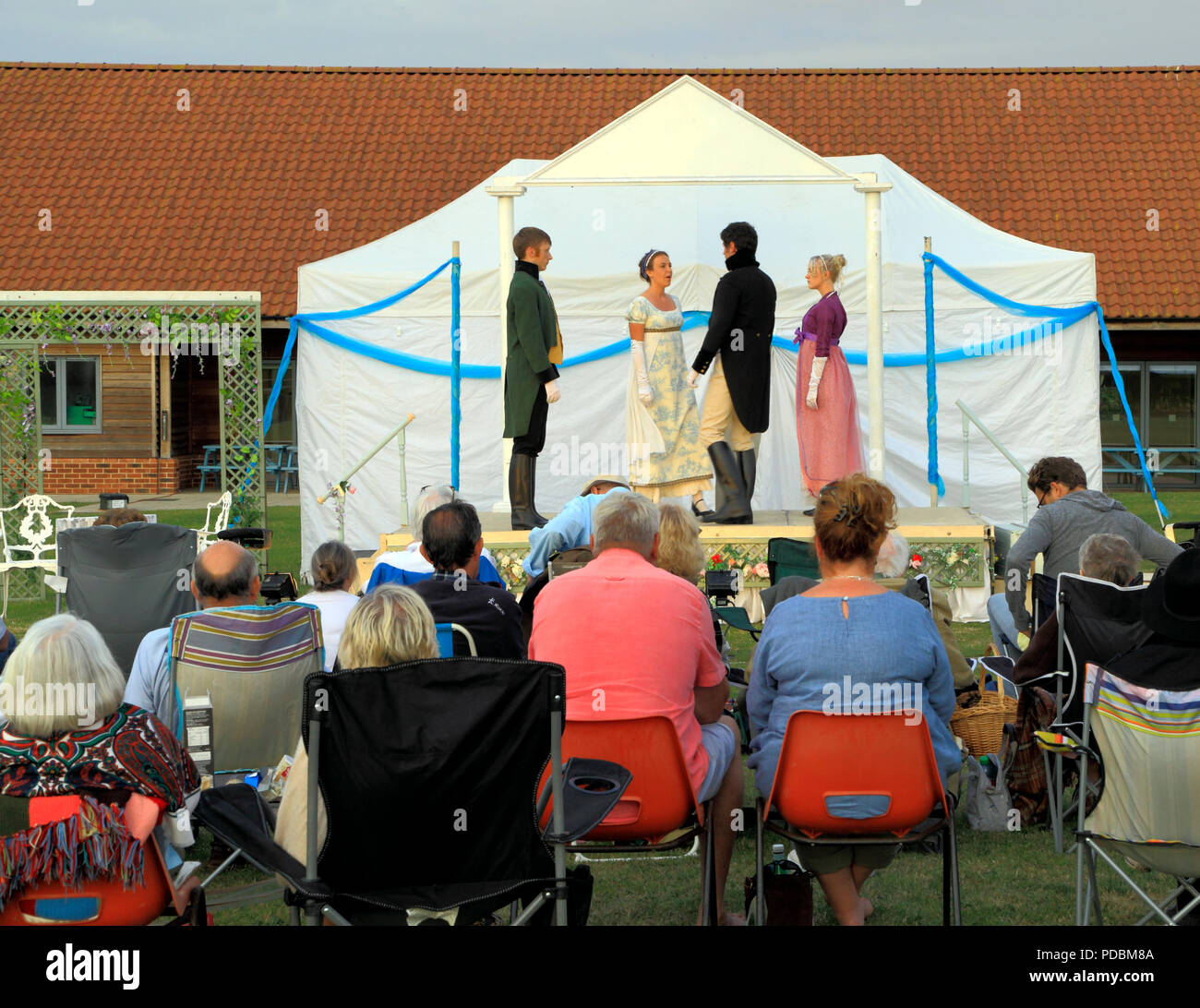 Open air Theatre, Heartbreak Productions, Pride and Prejudice, audience, outdoor, stage,Thornham, Norfolk, UK - Stock Image