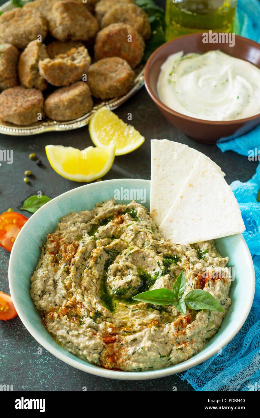 Arabic cuisine. Fresh homemade creamy mung hummus. Ramadan food. - Stock Image