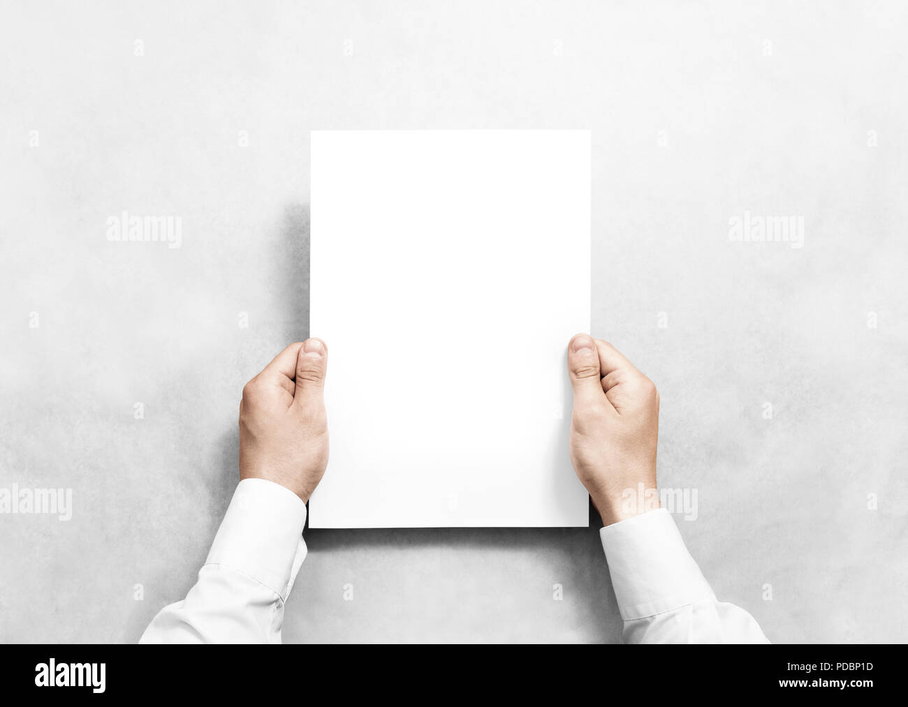 hand holding white blank paper sheet mockup isolated arm in shirt