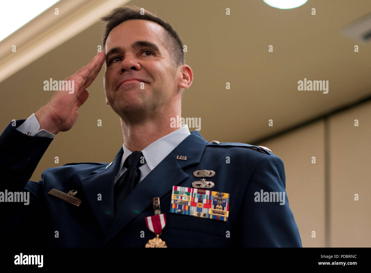 Lt. Col. Hamilton Underwood, 4th Combat Camera Squadron commander, renders a final salute to his unit members during a change of command ceremony Aug. 3, 2018, at Joint Base Charleston, S.C. Underwood passed command of the 4th CTCS to Lt. Col. Chad Gibson, who previously served as the deputy director for Air Force Reserve Command public affairs. The 4th CTCS is the only Reserve combat camera unit and is a rapid response force, specializing in aerial documentation. (U.S. Air Force photo by Tech. Sgt. Jamal D. Sutter) Stock Photo