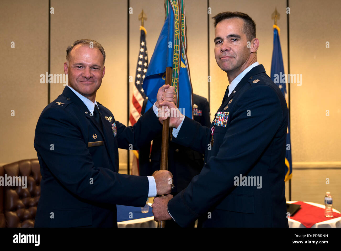 Col. Stephen Lanier, left, 315th Operations Group commander, receives the 4th Combat Camera Squadron guidon from Lt. Col. Hamilton Underwood, 4th CTCS commander, during a change of command ceremony Aug. 3, 2018, at Joint Base Charleston, S.C. The 4th CTCS is the only Reserve combat camera unit and is a rapid response force, specializing in aerial documentation. Underwood joined the unit in March 2001 and served a variety of positions before taking command for the first time in 2014. (U.S. Air Force photo by Tech. Sgt. Jamal D. Sutter) Stock Photo