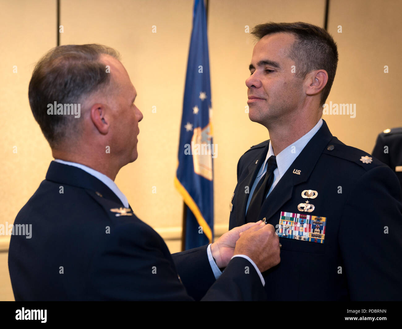 Col. Stephen Lanier, 315th Operations Group commander, presents a Meritorious Service Medal to Lt. Col. Hamilton Underwood, 4th Combat Camera Squadron commander, during a change of command ceremony Aug. 3, 2018, at Joint Base Charleston, S.C. The 4th CTCS is the only Reserve combat camera unit and is a rapid response force, specializing in aerial documentation. Underwood served as the 4th CTCS commander from 2014 to 2015, and again from 2017 to 2018 after the unit reactivated. (U.S. Air Force photo by Tech. Sgt. Jamal D. Sutter) Stock Photo