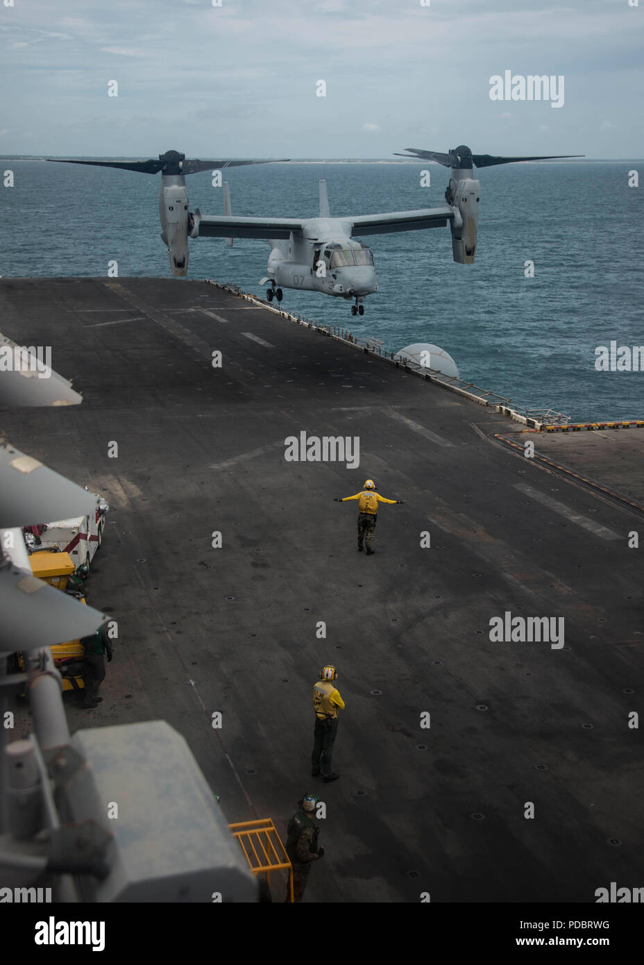 180803-N-ZG607-0025  ATLANTIC OCEAN (Aug. 3, 2018) An MV-22B Osprey, attached to Marine Medium Tiltrotor Squadron (VMM) 162 (Reinforced), prepares to land on the flight deck of the Wasp-class amphibious assault ship USS Iwo Jima (LHD 7), Aug. 3, 2018. Iwo Jima is deployed with its amphibious ready group in support of maritime security operations and theatre security cooperation efforts in Europe and the Middle East. (U.S. Navy photo by Mass Communication Specialist 3rd Class Dominick A. Cremeans/Released) Stock Photo