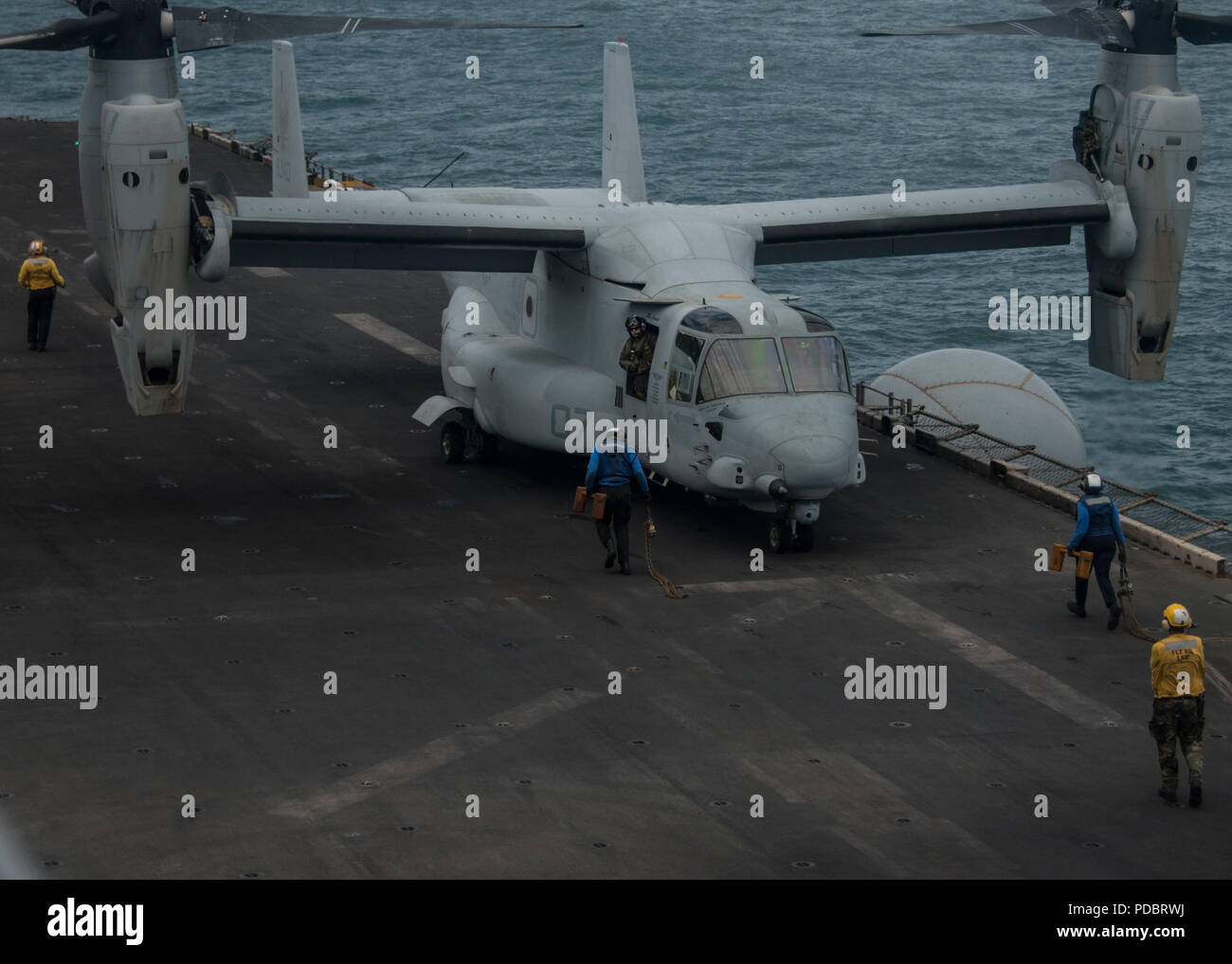 180803-N-ZG607-0027  ATLANTIC OCEAN (Aug. 3, 2018) An MV-22B Osprey, attached to Marine Medium Tiltrotor Squadron (VMM) 162 (Reinforced), lands on the flight deck of the Wasp-class amphibious assault ship USS Iwo Jima (LHD 7), Aug. 3, 2018. Iwo Jima is deployed with its amphibious ready group in support of maritime security operations and theatre security cooperation efforts in Europe and the Middle East. (U.S. Navy photo by Mass Communication Specialist 3rd Class Dominick A. Cremeans/Released) Stock Photo