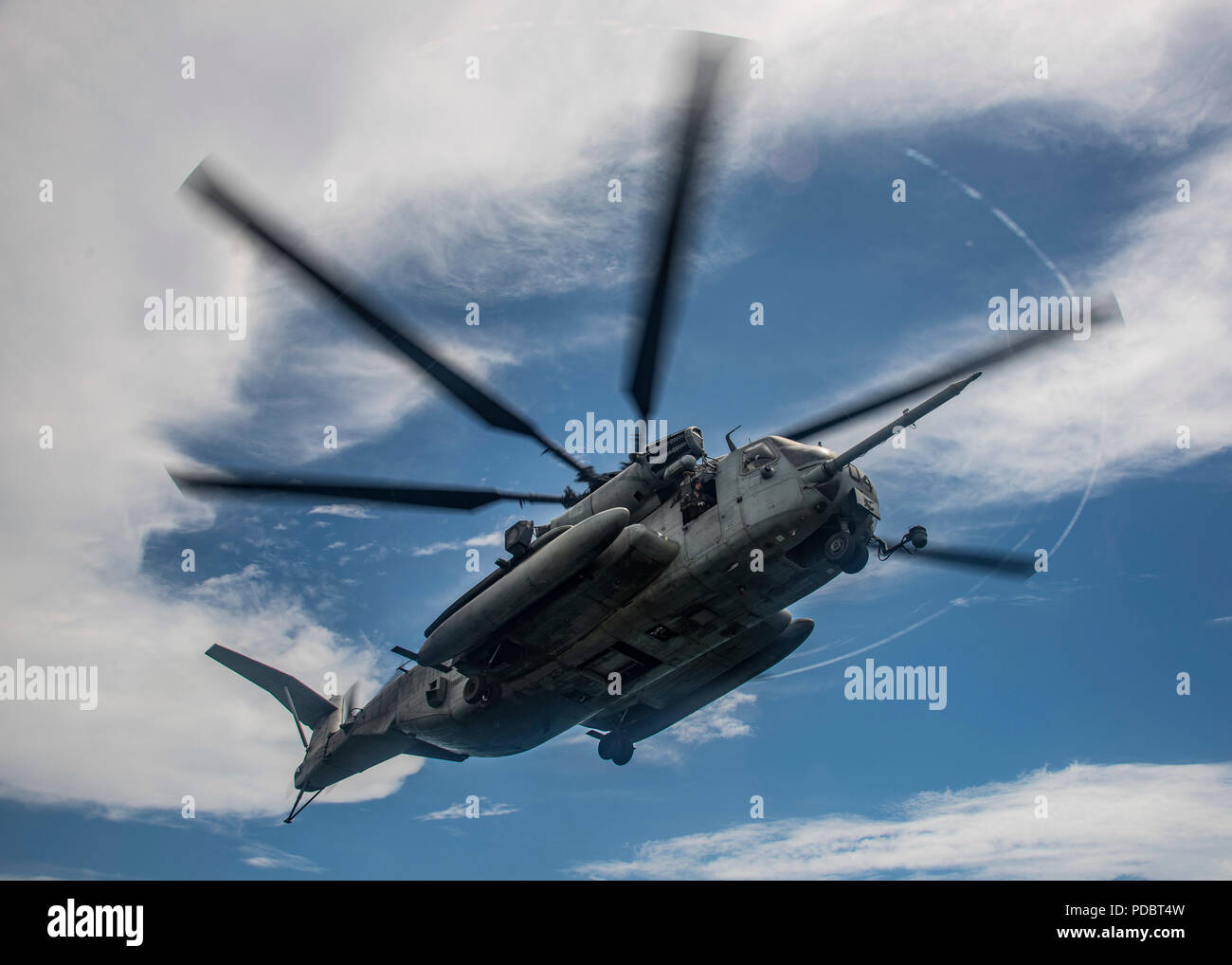 ATLANTIC OCEAN (Aug. 4, 2018) A CH-53E Super Stallion helicopter, attached to Marine Medium Tiltrotor Squadron (VMM) 162 (Reinforced), prepares to land on the Wasp-class amphibious assault ship USS Iwo Jima (LHD 7), Aug. 4, 2018. Iwo Jima is deployed with its amphibious ready group in support of maritime security operations and theatre security cooperation efforts in Europe and the Middle East. (U.S. Navy photo by Mass Communication Specialist 3rd Class Dominick A. Cremeans/Released) Stock Photo