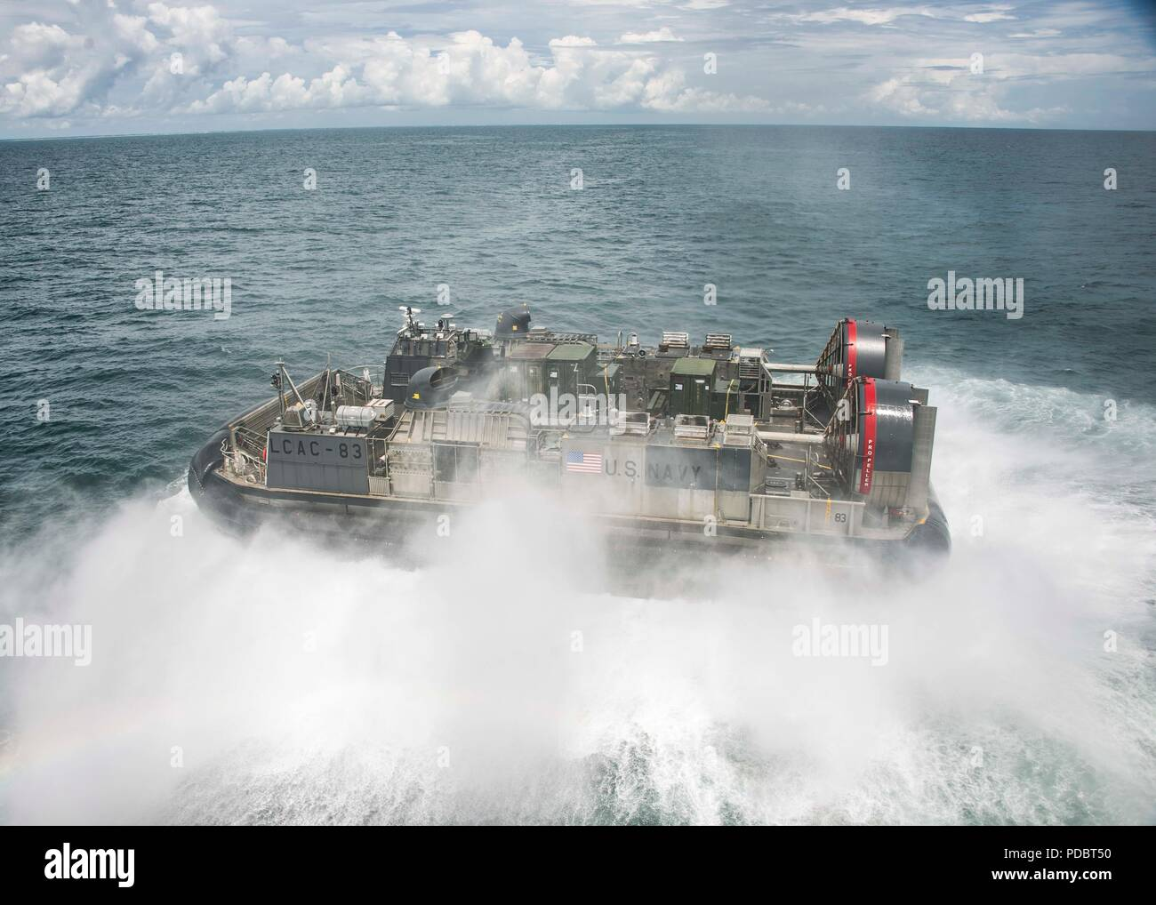 ATLANTIC OCEAN (Aug. 4, 2018) Landing Craft, Air Cushion 83, attached to Assault Craft Unit 4, departs the Wasp-class amphibious assault ship USS Iwo Jima (LHD 7), Aug. 4, 2018. Iwo Jima is deployed with its amphibious ready group in support of maritime security operations and theatre security cooperation efforts in Europe and the Middle East. (U.S. Navy photo by Mass Communication Specialist 3rd Class Dominick A. Cremeans/Released) Stock Photo