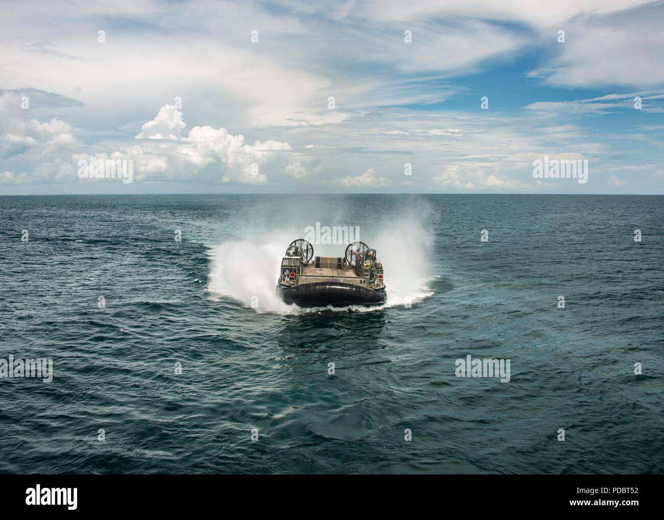 ATLANTIC OCEAN (Aug. 4, 2018) Landing Craft, Air Cushion 84, attached to Assault Craft Unit 4, approaches the Wasp-class amphibious assault ship USS Iwo Jima (LHD 7), Aug. 4, 2018. Iwo Jima is deployed with its amphibious ready group in support of maritime security operations and theatre security cooperation efforts in Europe and the Middle East. (U.S. Navy photo by Mass Communication Specialist 3rd Class Dominick A. Cremeans/Released) Stock Photo