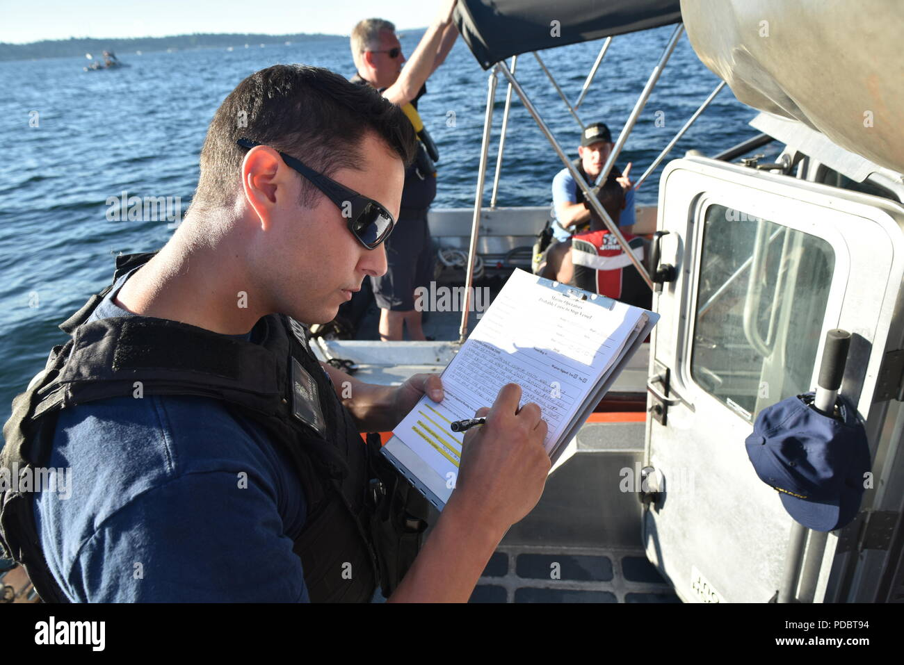 Coast Guard Petty Officer 2nd Class Mark Keightley, a boarding