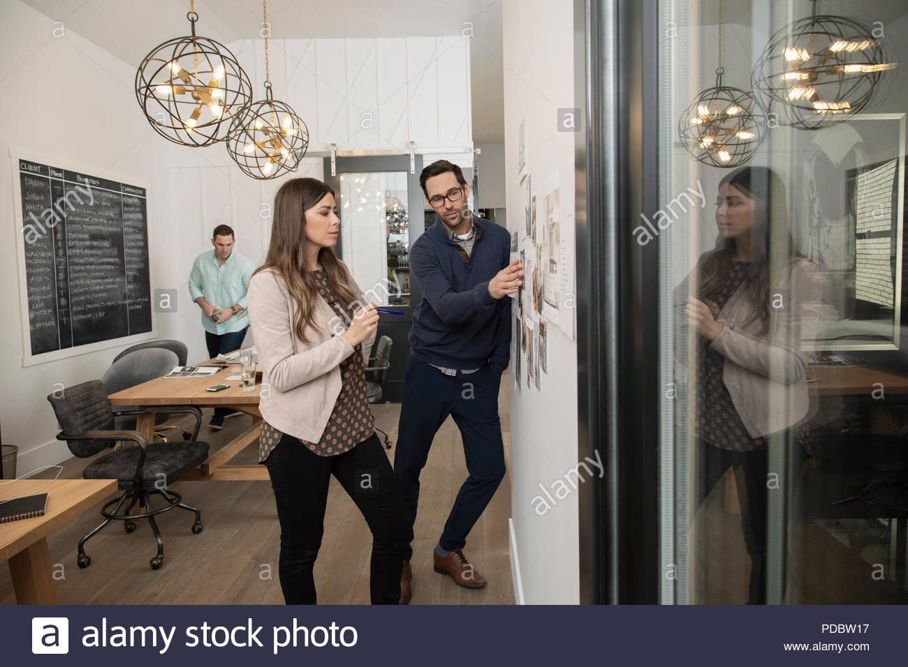 Home builder architect and designer planning at wall in office - Stock Image