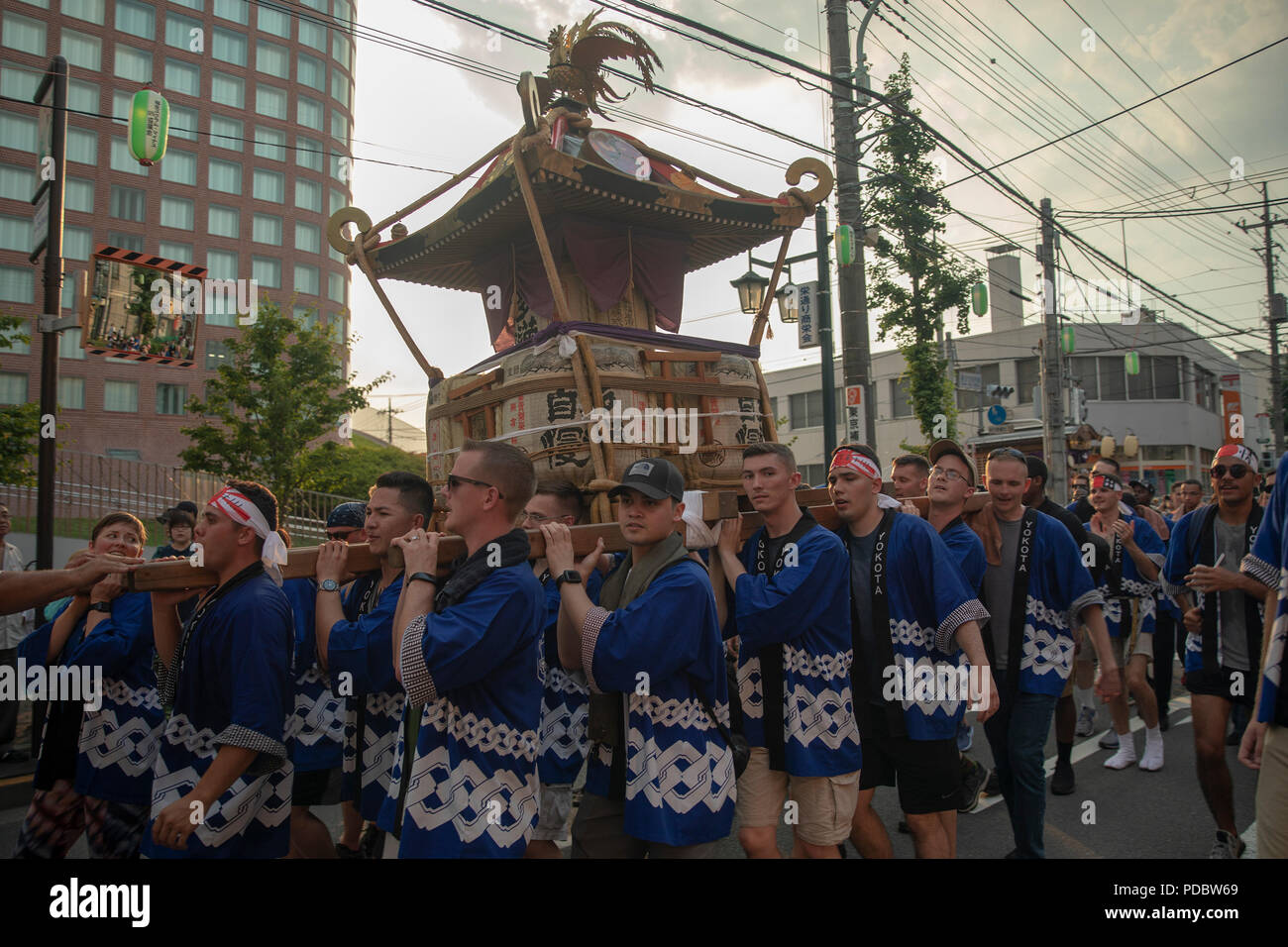 Members from Yokota Air Base carry the 374th Airlift Wing's official mikoshi during the 68th Annual Fussa Tanabata Festival at Fussa City, Japan, Aug. 3, 2018. More than 70 volunteers from Yokota carried the mikoshi during this year's festival. Yokota Airmen have attended the festival since 1958 and have actively participated in carrying a mikoshi since 1975. (U.S. Air Force photo by Yasuo Osakabe) - Stock Image
