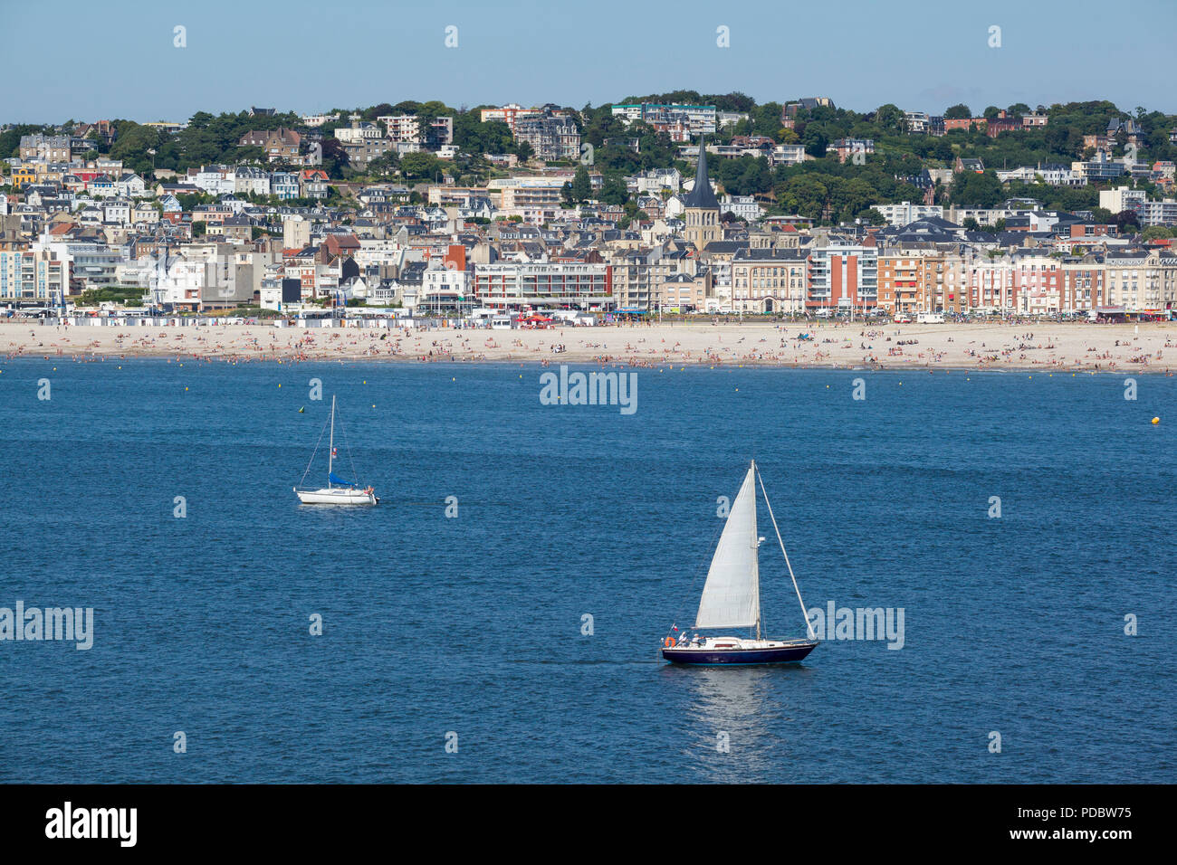 A view from the sea showing sailing boats in front of the beach at Sainte Adresse, Le Havre, Normandy, France - Stock Image