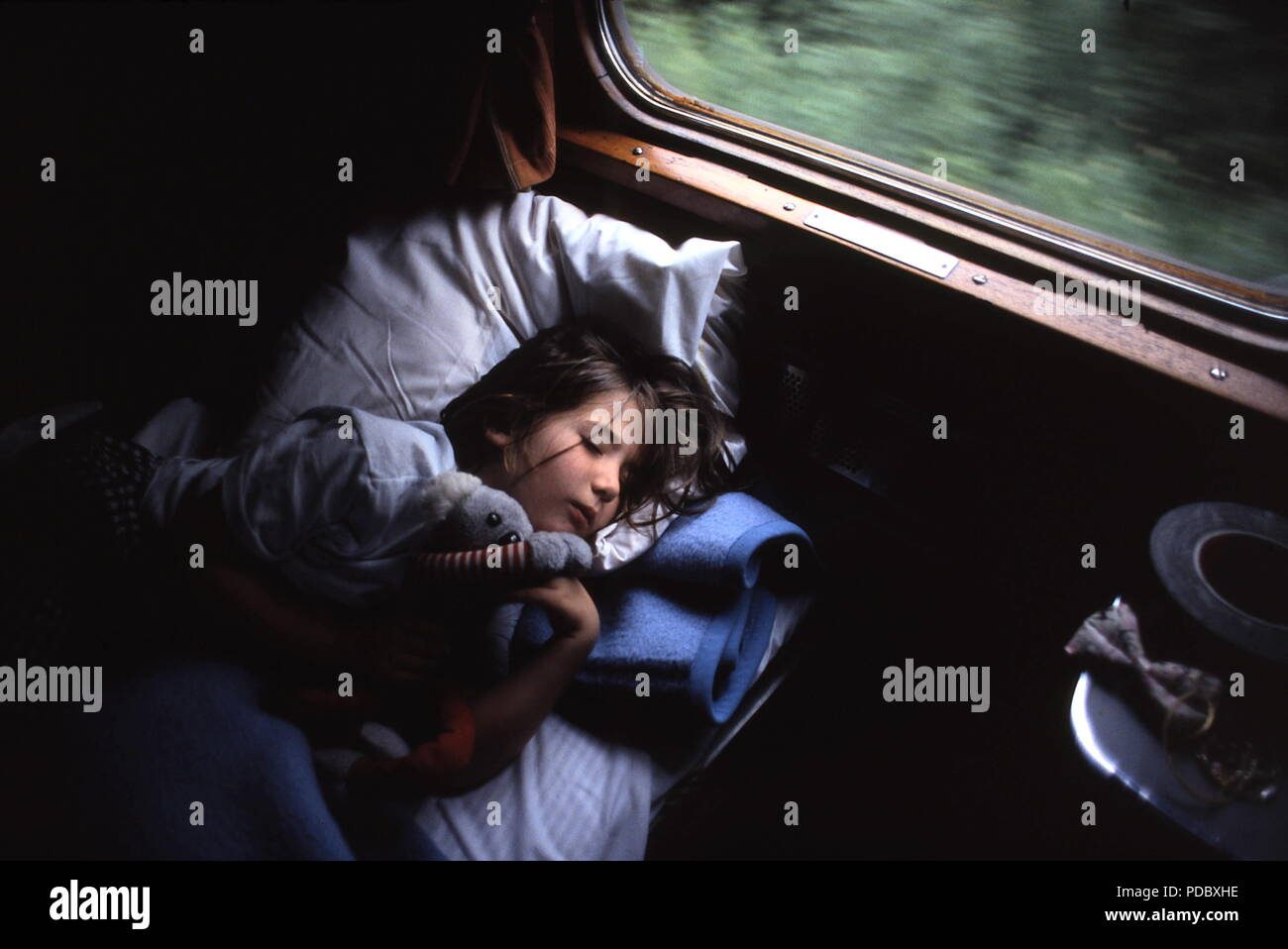 AJAXNETPHOTO. STOCKHOLM - LULEA, SWEDEN. - NIGHT TRAIN - YOUNG CHILD RESTING IN BERTH ON OVERNIGHT SLEEPER TRAIN FROM THE CAPITAL TO LULEA NEAR ARCTIC CIRCLE. PHOTO:JONATHAN EASTLAND/AJAX REF:920259 - Stock Image