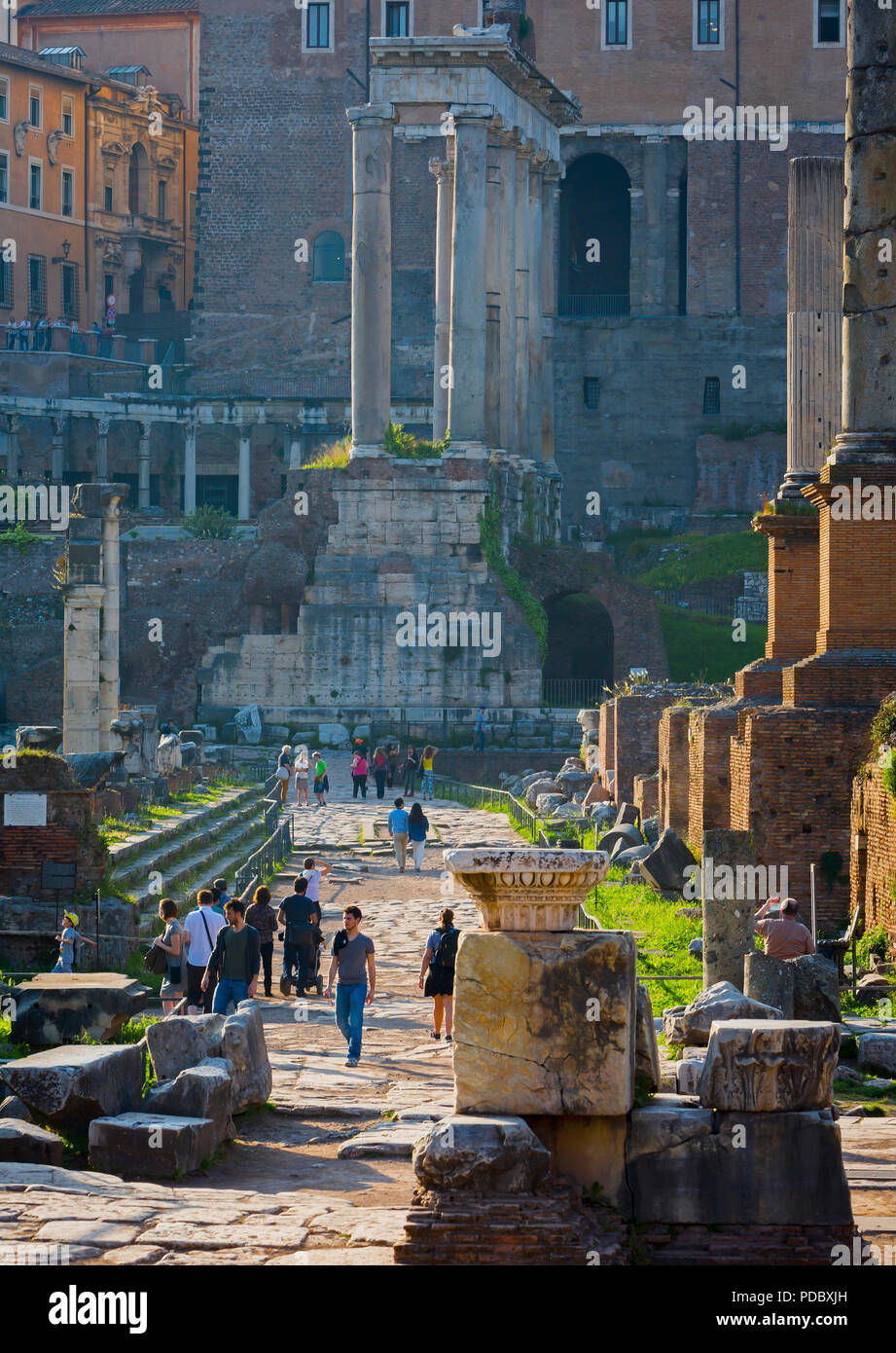 Rome, Italy.  The Roman Forum with the Temple of Saturn (Tempio di Saturno) in background. - Stock Image