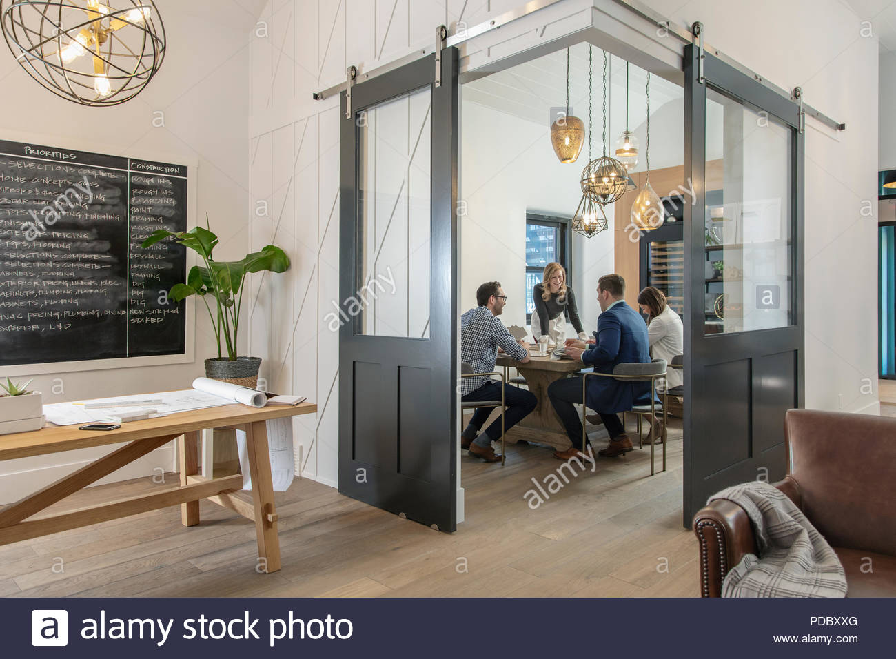 Home builder architects and designers planning in office meeting - Stock Image