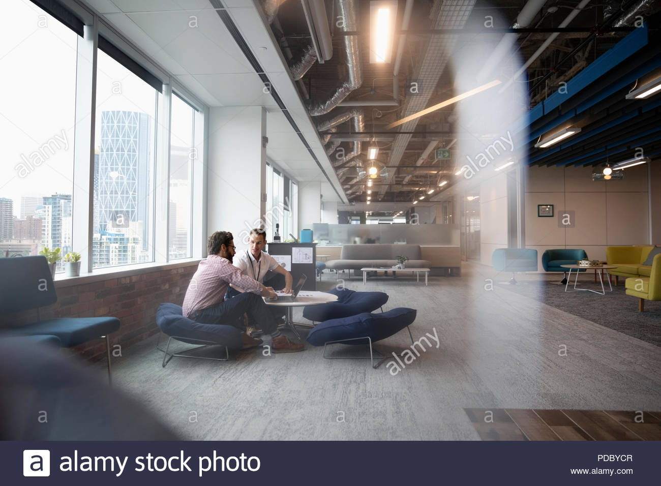 Creative Businessmen Meeting In Office Lounge   Stock Image