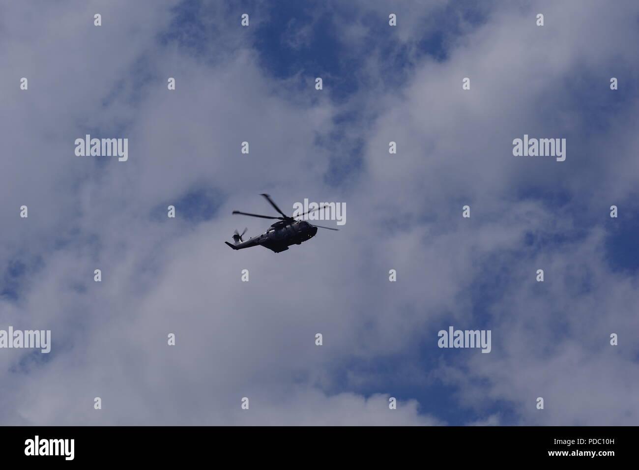 British Military Helicopter Flying over Dawlish Warren, Devon, UK. August, 2018. - Stock Image