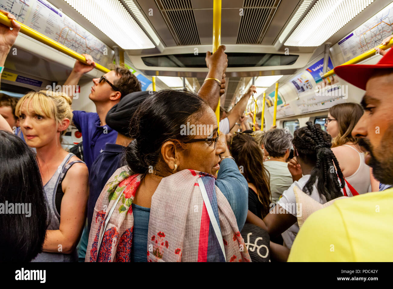 A Busy London Underground Train, London, England - Stock Image