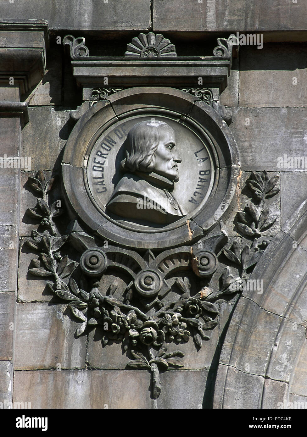Pedro Calderon de la Barca (Madrid, 1600-1681). Spanish poet, dramatist and writer of the Spanish Golden Age. Relief on a medallion. Facade of the National Library, detail. Madrid, Spain. - Stock Image