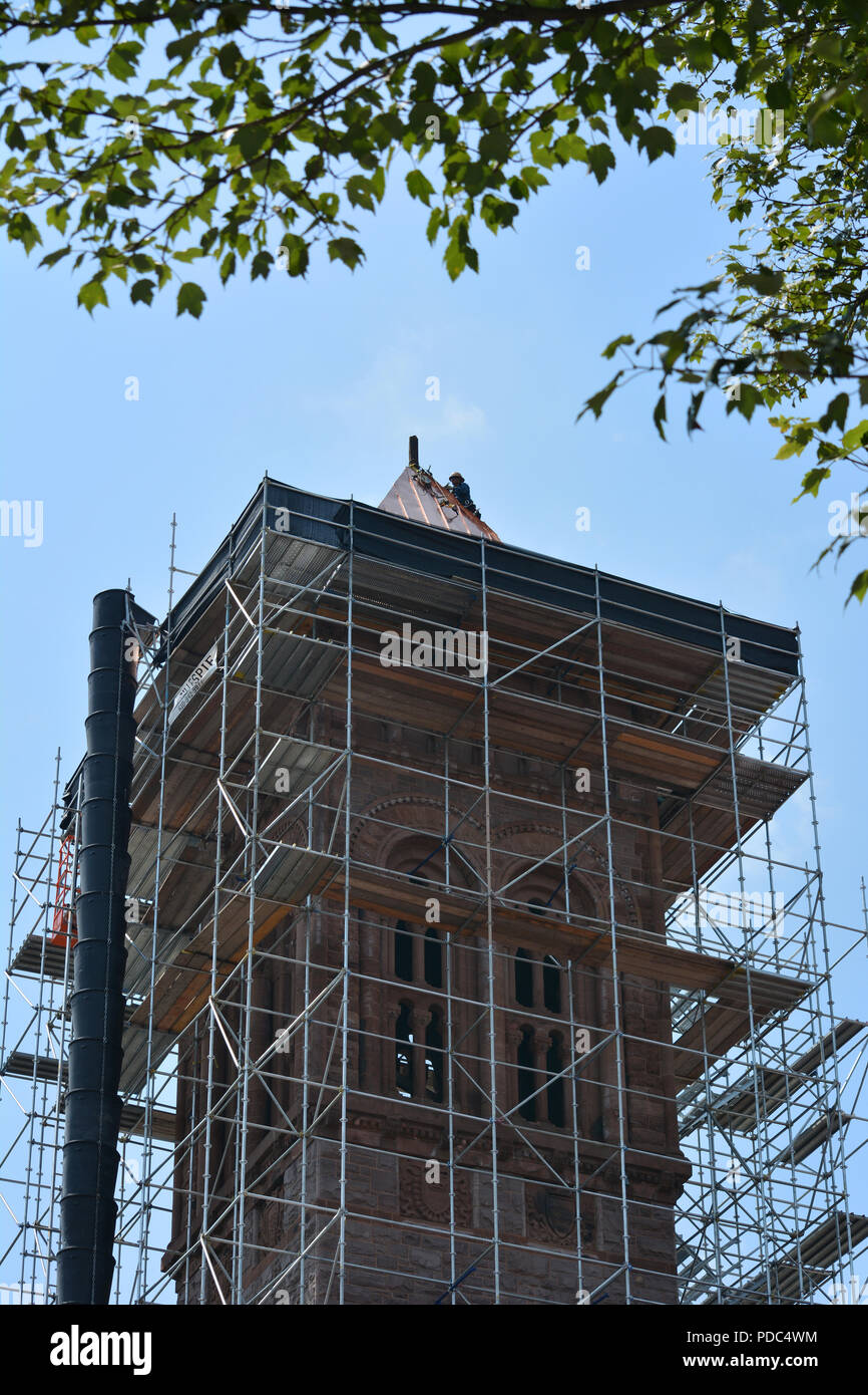 Roofer August, 8, 2018 putting a new copper roof on the First Presbyterian Church tower Wilkes Barre, Pennsylvania.Hot near 90 degrees F.and humid. Stock Photo