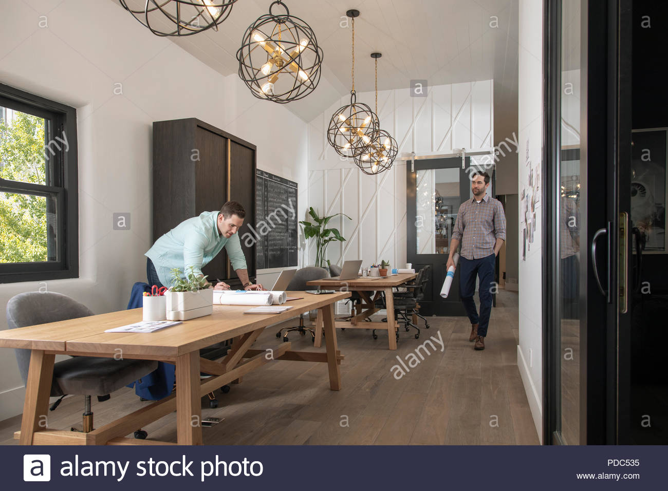 Home builder architect and designer working in office - Stock Image