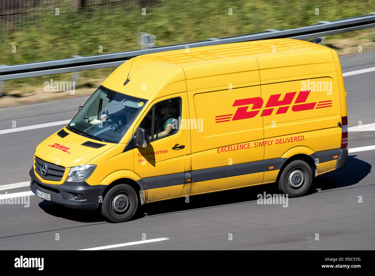 83f6cedda36830 DHL delivery van on motorway. DHL is a division of the German logistics  company Deutsche