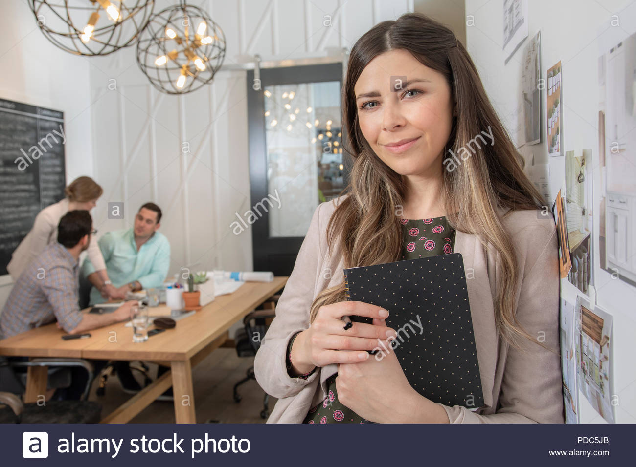 Portrait confident female home builder architect in office - Stock Image
