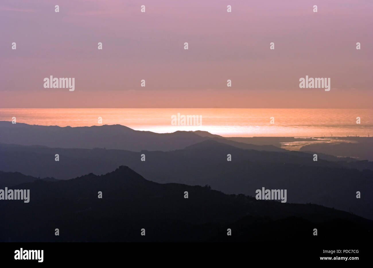 Interesting image seeing mountain layers and sea at sunset in the north of Portugal - Stock Image