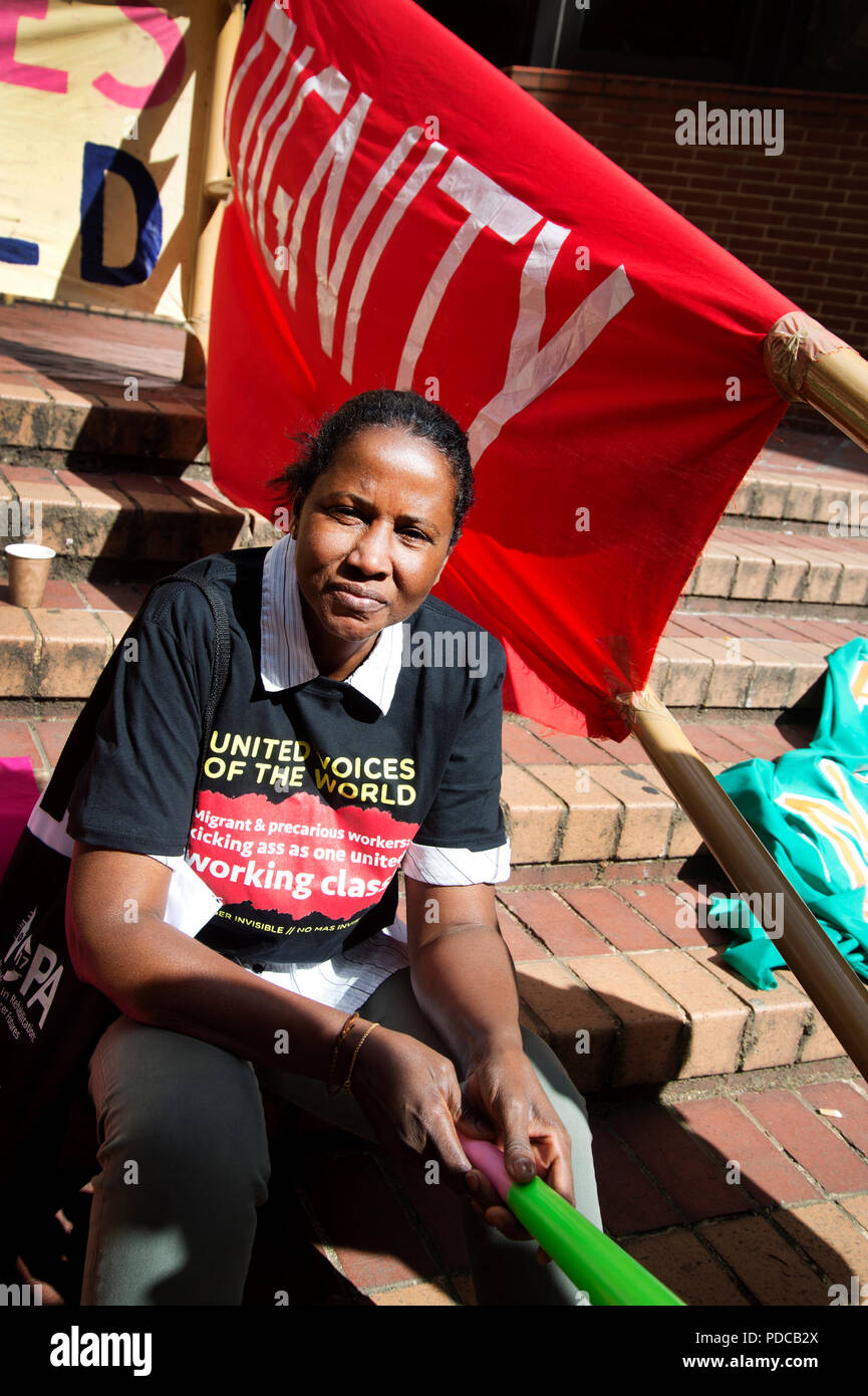 London, UK. 8th August, 2018. Kensington and Chelsea Town Hall, London. Cleaners from the United Voices of the World Union strike for three days demanding they be paid the London Living Wage of £10.20 an hour instead of the minimum wage of £7.83 that they currently get. Fatima from Portugal. Credit: Jenny Matthews/Alamy Live News - Stock Image