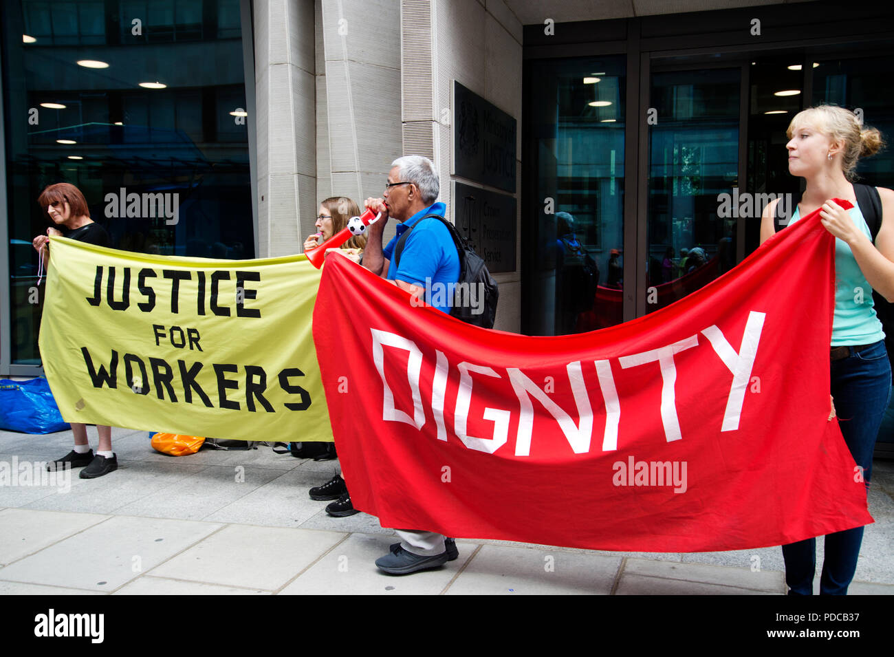 London, UK. 8th August, 2018. Ministry of Justice, Petty France, London. Cleaners from the United Voices of the World Union strike for three days demanding they be paid the London Living Wage of £10.20 an hour instead of the minimum wage of £7.83 that they currently get. Credit: Jenny Matthews/Alamy Live News - Stock Image